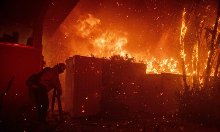 Firefighters try to save a home on Tigertail Road from the Getty fire, in Los Angeles, Calif., on Oct. 28, 2019. (Christian Monterrosa/AP Photo)