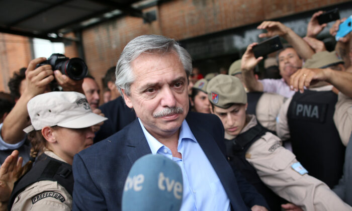 Then presidential candidate Alberto Fernandez leaves a polling station after casting his vote, in Buenos Aires, Argentina, on Oct. 27, 2019. (Agustin Marcarian/Reuters)