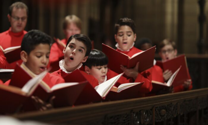 St. Thomas Choir School boys continue the tradition that Dr. T. Tertius Noble set back in 1919 when he founded the school, aiming for the highest standards for music at St. Thomas. (Ira Lippke)