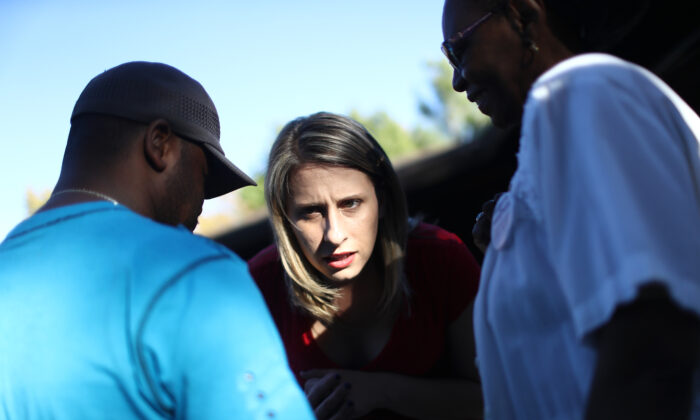 Democratic congressional candidate Katie Hill speaks to a supporter at a campaign Halloween carnival in Lancaster, Calif., on Oct. 21, 2018. (Mario Tama/Getty Images)