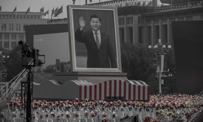 A giant portrait of Chinese leader Xi Jinping is carried atop a float at parade to celebrate the 70th Anniversary of the Chinese Communist Party's ruling at Tiananmen Square in Beijing, China on October 1, 2019. (Kevin Frayer/Getty Images)