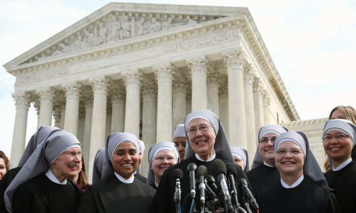 Mother Loraine Marie Maguire, of the Little Sisters of the Poor, speaks to the media after arguments at the US Supreme Court in Washington on March 23, 2016. (Mark Wilson/Getty Images)