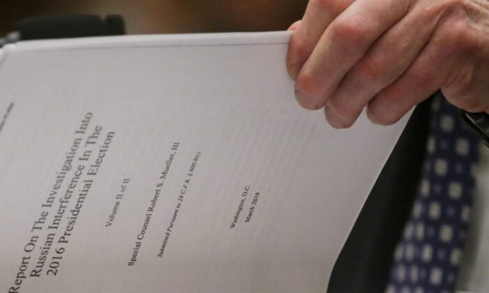 Former Special Counsel Robert Mueller references a copy of his report as he testifies before a House Judiciary Committee hearing on the Office of Special Counsel's investigation into Russian Interference in the 2016 Presidential Election on Capitol Hill in Washington on July 24, 2019. (Leah Millis/File Photo/Reuters)
