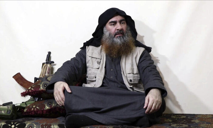 This file image made from video posted on a militant website April 29, 2019, purports to show the leader of ISIS, Abu Bakr al-Baghdadi, being interviewed by his group's Al-Furqan media outlet. (Al-Furqan media via AP, File)