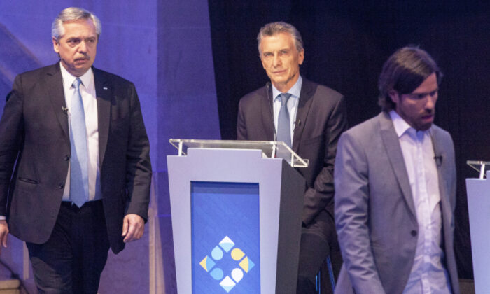 Presidential Candidates Alberto Fernandez for Frente de Todos Party (L) and Nicolas del Cañofor FIT Party, walks past Argentinian President and Candidate Mauricio Macri (C) during the first session of the Argentine presidential debate at Universidad Nacional del Litoral on Oct. 13, 2019 in Santa Fe, Argentina. (Ricardo Ceppi/Getty Images)