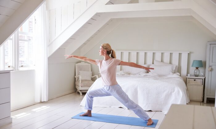 Yoga may mitigate age-related and neurodegenerative decline, according to a review of related studies. (Monkey Business Images/Shutterstock)