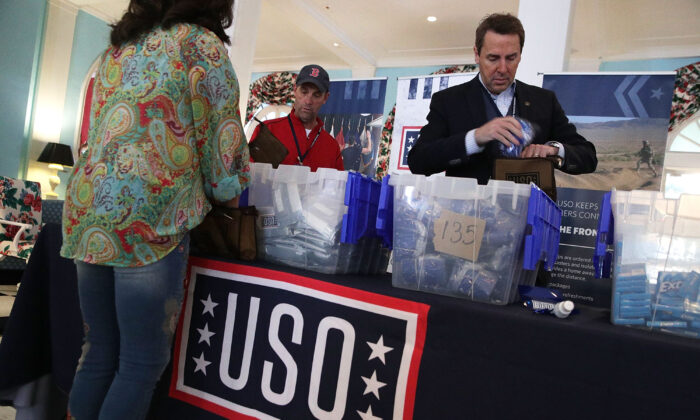 Rep. Steve Knight, second from right, prepares care packages for USO with Rep. Mark Walker (R-N.C.) in a file photograph. (Alex Wong/Getty Images)