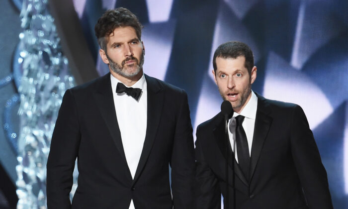 Writer/producers David Benioff (L) and D.B. Weiss (R) accept Outstanding Writing for a Drama Series during the 68th Annual Primetime Emmy Awards at Microsoft Theater in Los Angeles, Calif., on Sept. 18, 2016. (Kevin Winter/Getty Images)