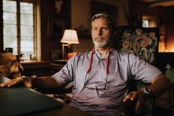 Warner IV at his desk