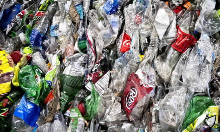In this Nov. 15, 2016, file photo, crushed plastic bottles sit in a bale following sorting at the Mid-America Recycling plant, in Lincoln, Neb. Francis Gardler/The Journal-Star via AP, File