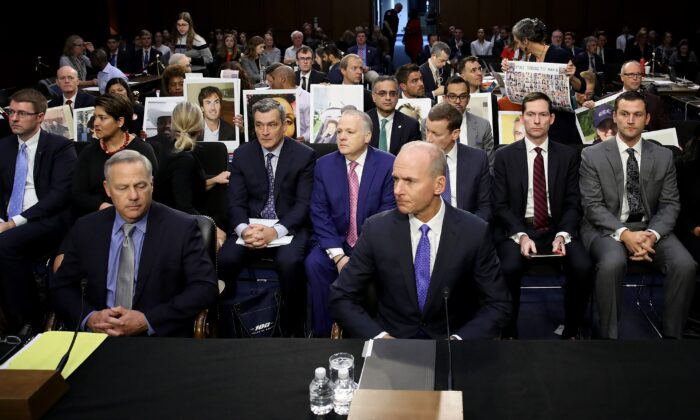 Dennis Muilenburg (R), President and CEO of the Boeing Company, and John Hamilton (L), Vice President and Chief Engineer of Boeing Commercial Airplanes, before a hearing by the Senate Commerce Committee in Washington on Oct. 29, 2019. (Win McNamee/Getty Images)