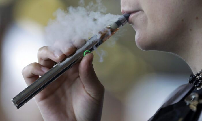 British Columbia's school trustees are asking for help to stop students from vaping. Members have approved a motion urging federal and provincial governments to make funding available for vape education and cessation for students. (AP Photo/Tony Dejak, File)