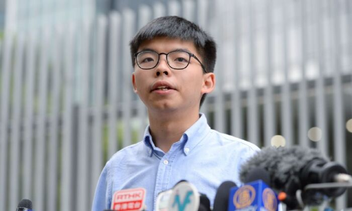 Pro-democracy activist Joshua Wong speaks to the media outside the Legislative Council in Hong Kong on Oct. 29, 2019. (Sung Pi Lung/The Epoch Times)
