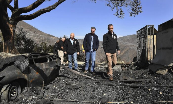From (L), L.A. City Councilman Mike Bonin, California Governor Gavin Newsom and L.A. City Mayor Eric Garcetti tour a burned home along Tigertail Road in Brentwood, Calif., on Oct. 29, 2019. (Wally Skalij/Los Angeles Times via AP, Pool)