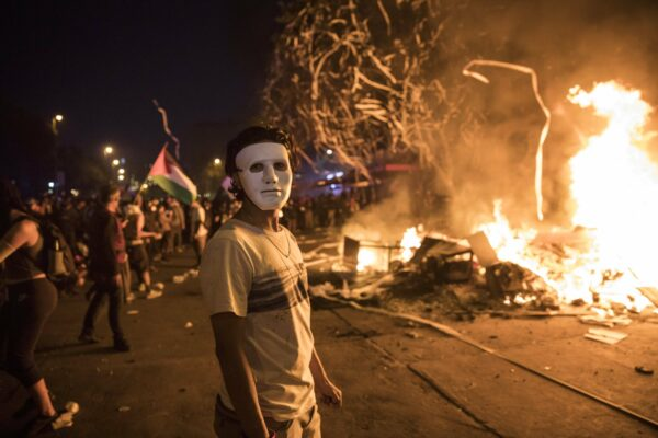 A masked anti-government protester