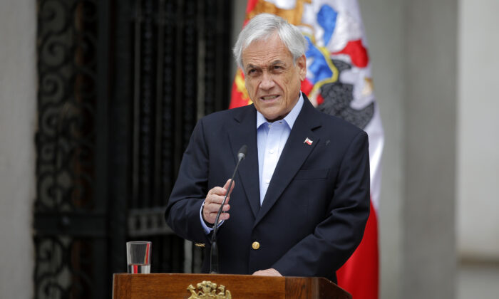 Chilean President Sebastian Pinera addresses the nation in Santiago, on Oct. 26, 2019. (Pedro Lopez/AFP via Getty Images)