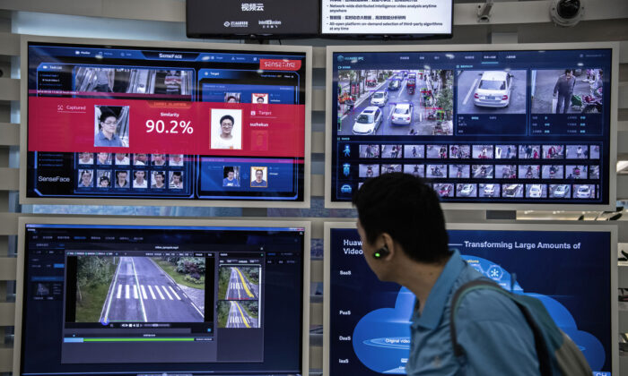A display for facial recognition and artificial intelligence is seen on monitors at Huawei's Bantian campus on April 26, 2019 in Shenzhen, China. (Kevin Frayer/Getty Images)