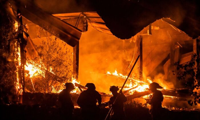 Firefighters tend to a structure lost during the Kincade fire off Highway 128, east of Healdsburg, Calif., on Oct. 29, 2019. (Philip Pacheco/AFP via Getty Images)