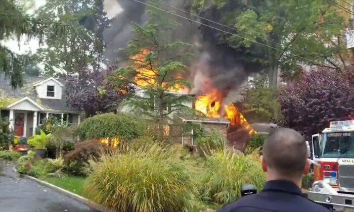 One of the two houses that caught fire after a small plane crashed into the house in the Colonia section of Woodbridge Township, N.J., on Oct. 29, 2019. (Video screenshot/ Michael Yonone via Reuters)