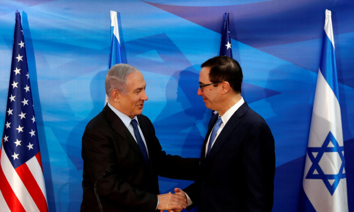 Israeli Prime Minister Benjamin Netanyahu and U.S. Treasury Secretary Steven Mnuchin shake hands as they deliver joint statements during their meeting in Jerusalem  on Oct. 28, 2019. (Ronen Zvulun/Reuters)