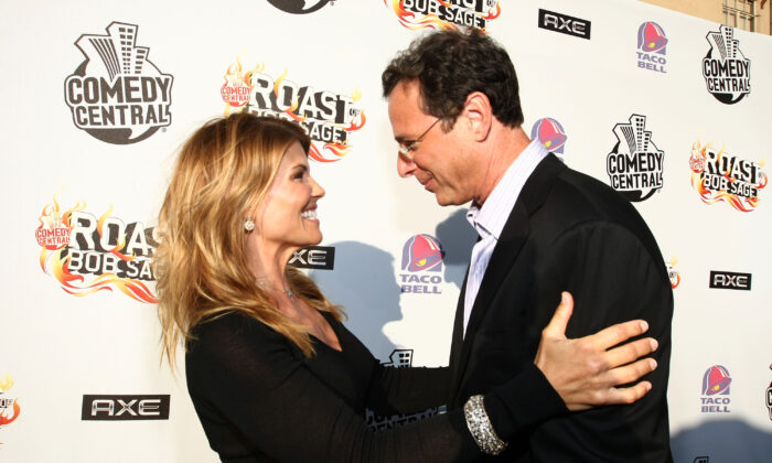 "Actress Lori Loughlin and actor/comedian Bob Saget arrive to ""Comedy Central Roast Of Bob Saget"" at the Warners Brothers Studio Lot in Burbank, Calif. on Aug. 3, 2008. (Alberto E. Rodriguez/Getty Images for Comedy Central)"