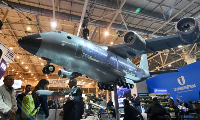 """A model of an Antonov An-188 plane, with engines made by Motor Sich, is seen at the """"Arms and Security"""" expo in Kyiv, Ukraine, on Oct. 10, 2018. (Genya Savilov/AFP/Getty Images)"""