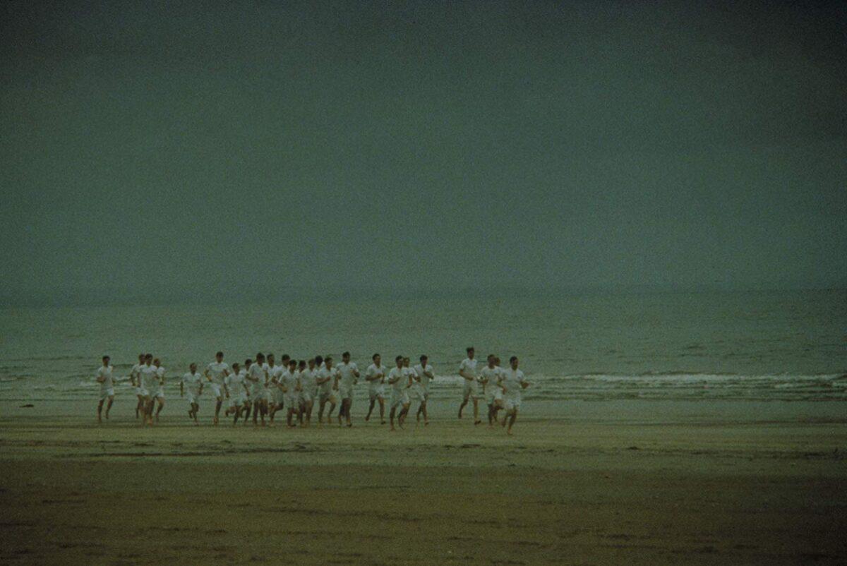 runners on the beach at dawn