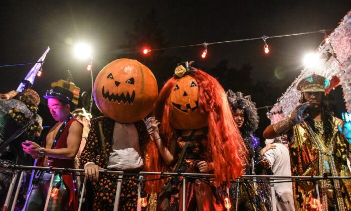 People in costumes participate in the annual Village Halloween parade on Sixth Avenue on Oct. 31, 2018 in New York City. (Stephanie Keith/Getty Images)