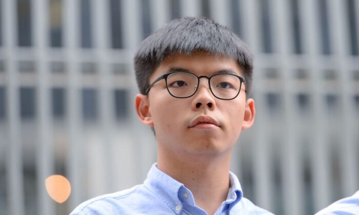 Pro-democracy activist Joshua Wong speaks to the media outside the Legislative Council (LegCo) in Hong Kong on Oct. 29, 2019. (Sung Pi Lung/The Epoch Times)