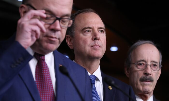 House Intelligence Committee Chairman Rep. Adam Schiff (D-Calif.), center, attends a press conference after the close of a vote by the U.S. House of Representatives on a resolution formalizing the impeachment inquiry centered on President Donald Trump in Washington on Oct. 31, 2019. (Chip Somodevilla/Getty Images)
