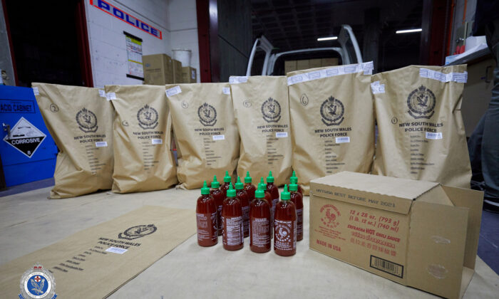 Seized bottles of sriracha hot chilli sauce, which were later found to conceal crystal meth, or ice, are seen in Sydney, Australia Oct. 15, 2019. Picture taken Oct. 15, 2019.  (New South Wales Police Force/Handout via Reuters)