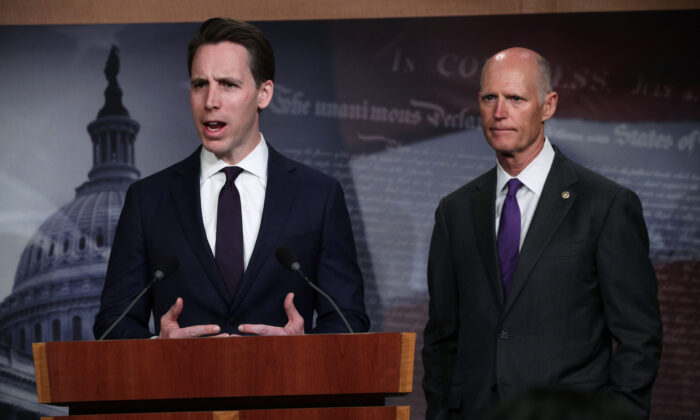 U.S. Sen. Josh Hawley (R-MO) (L) and Sen. Rick Scott (R-FL) (R) listens during a news conference at the U.S. Capitol in Washington, on April 2, 2019. (Alex Wong/Getty Images)