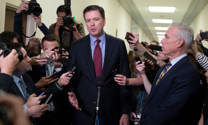 Former FBI Director James Comey (C) talks to reporters following a closed House Judiciary Committee meeting to hear his testimony, on Capitol Hill in Washington on Dec. 7, 2018. (Alex Edelman/AFP/Getty Images)