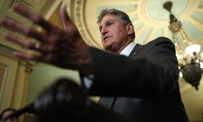 Sen. Joe Manchin (D-W.Va.) speaks to reporters in Washington in a July 2019 file photograph. (Win McNamee/Getty Images)