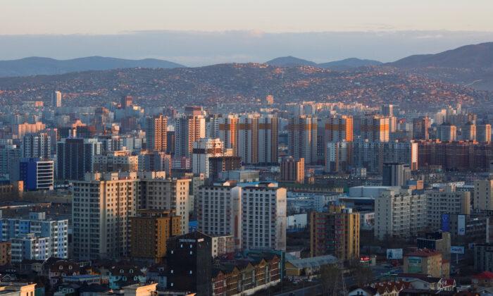 The sun rises over Ulaanbaatar, Mongolia on May 1, 2018. (Thomas Peter/Reuters)