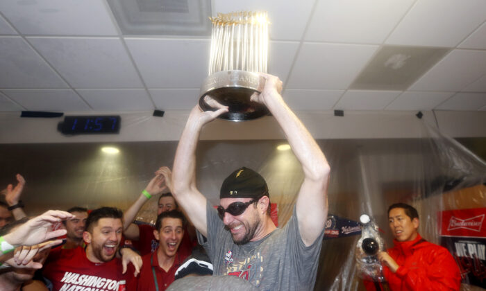 Max Scherzer #31 of the Washington Nationals celebrates in the locker room after defeating the Houston Astros in Game Seven to win the 2019 World Series at Minute Maid Park in Houston, Texas on Oct. 30, 2019. (Elsa/Getty Images)