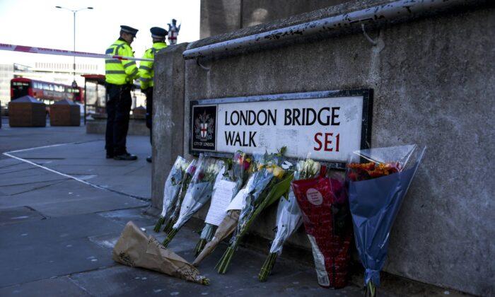 Flowers are left following the Nov. 29 terror attack on London Bridge in London, on Dec. 1, 2019. (Alberto Pezzali/AP Photo)