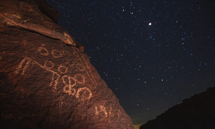 The moon is seen over an ancient Native American petroglyph in this file photo taken near Barstow, Calif., on Jan. 20, 2019. (David McNew/Getty Images)