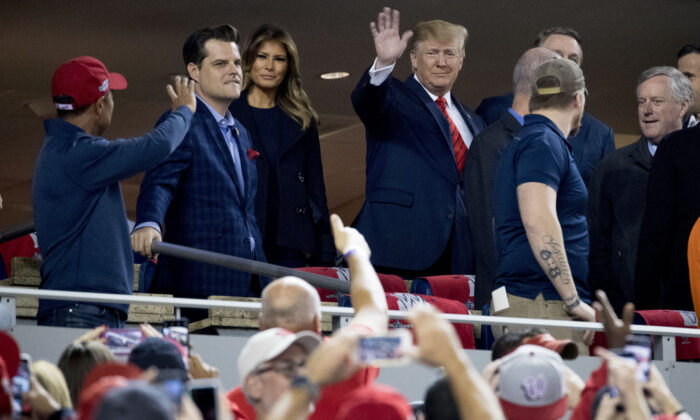 Then-President Donald Trump and former first lady Melania Trump, along with Rep. Matt Gaetz (R-Fla.) second from left. (Andrew Harnik/AP Photo)