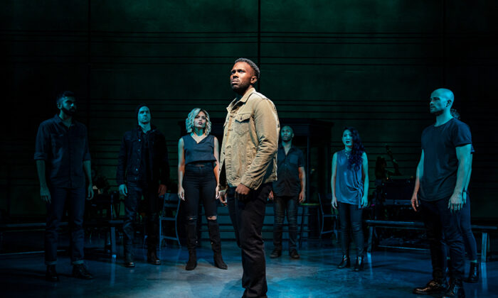 """Joshua Henry (C) surrounded by the cast of """"The Wrong Man."""" (Matthew Murphy)"""