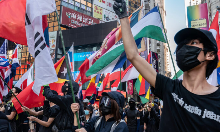 Pro-democracy protesters waves flags as they take part in a demonstration in Hong Kong, on Nov. 2, 2019. (Anthony Kwan/Getty Images)