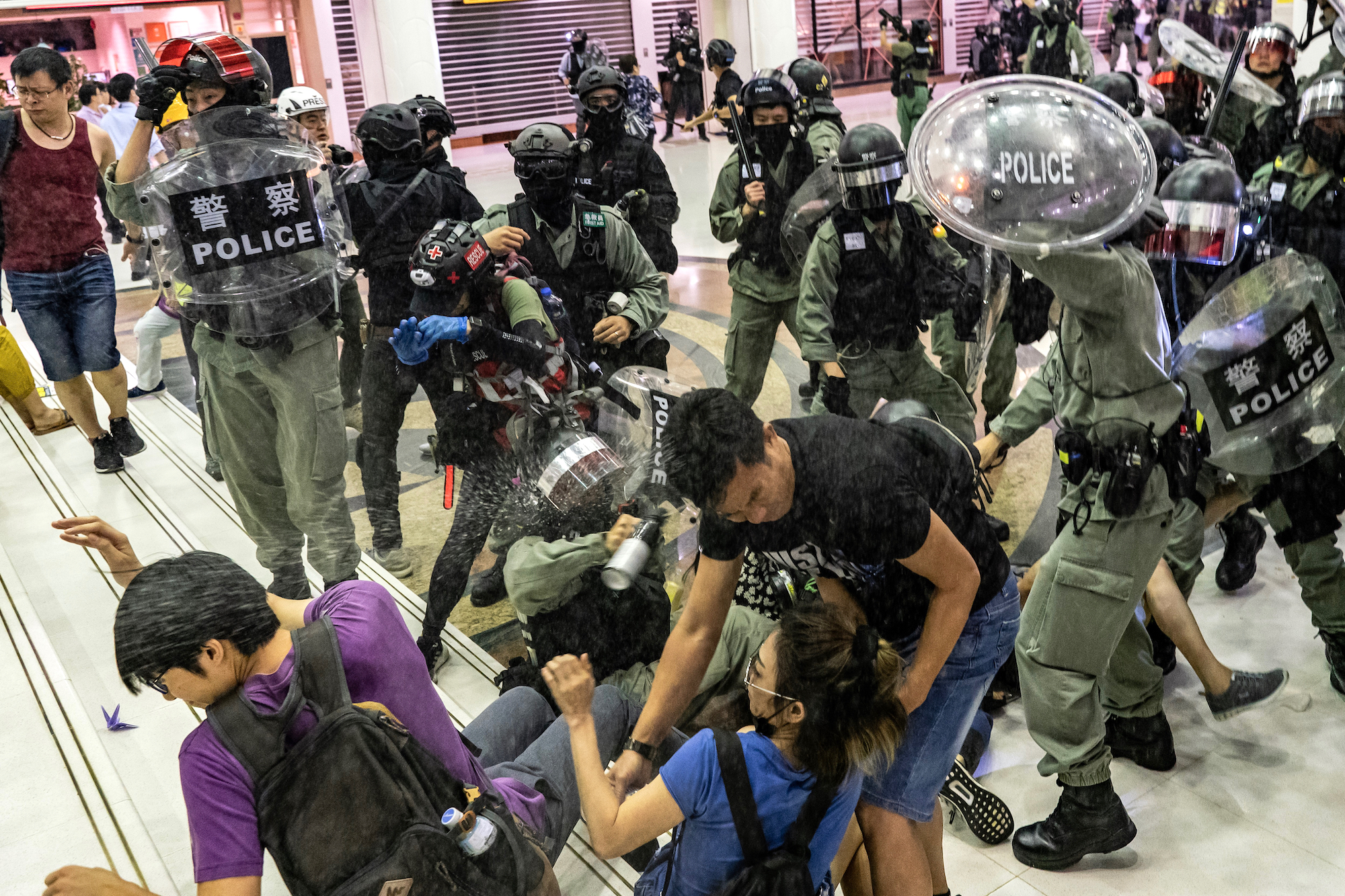 A riot police uses pepper spray.jpg