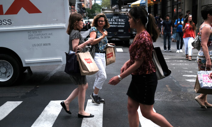 People walk along a shopping street in lower Manhattan in New York City on July 5, 2019. (Spencer Platt/Getty Images)