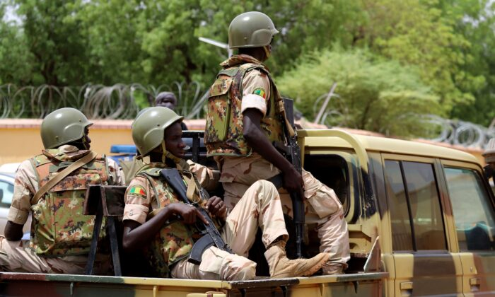 Members of the FAMA (Mali Armed Forces) patrol in the streets of Gao, Mali, on July 24, 2019. (Souleymane Ag Anara/AFP via Getty Images)