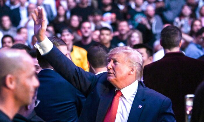 President Donald Trump waves to the crowd as he attends the Ultimate Fighting Championship at Madison Square Garden in New York City, N.Y., on Nov. 2, 2019. (Andrew Caballero-reynolds/AFP via Getty Images)