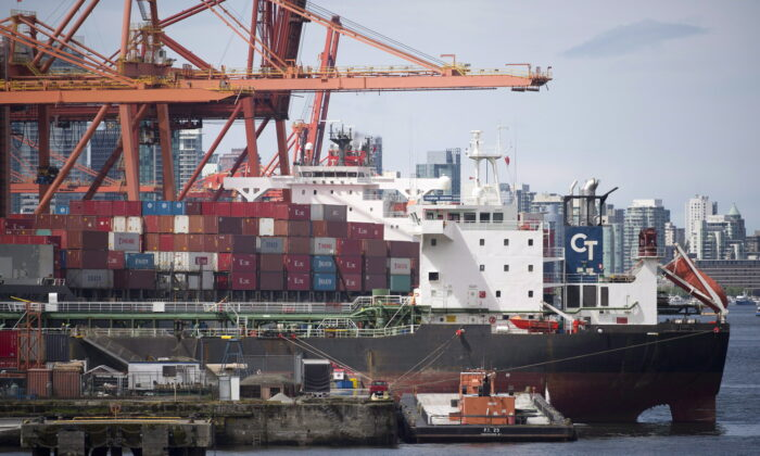 A cargo ship is loaded in Vancouver, B.C., in a file photo. (THE CANADIAN PRESS/Jonathan Hayward)
