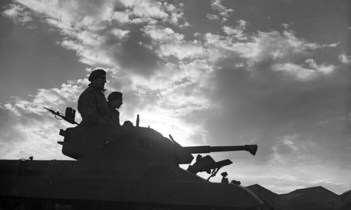 Silhouette of an American Locust tank and crew in 1944. (PNA Rota/Getty Images)