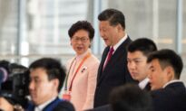 In Rare Meeting, China's Xi Backs Carrie Lam's Handling of Hong Kong Protests