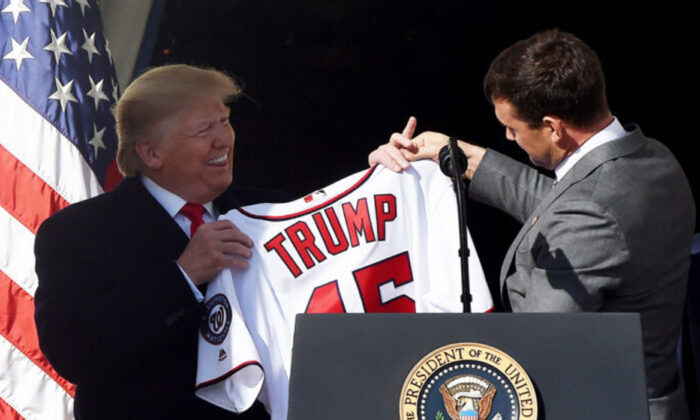 President Donald Trump received a jersey from Nationals player Ryan Zimmerman (R) during a ceremony to welcome the 2019 World Series Champions, the Washington Nationals, on the South Lawn of the White House on Nov. 4, 2019. (Olivier Douliery/AFP via Getty Images)