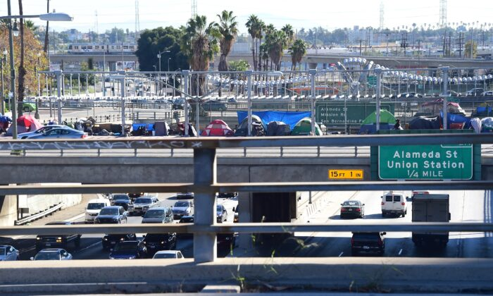 Tents occupied by the homeless line a freeway overpass in Los Angeles on Dec. 2, 2015. (Frederic J. Brown/AFP via Getty Images)